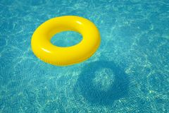 Colorful inflatable tube floating in swimming pool royalty free stock photography