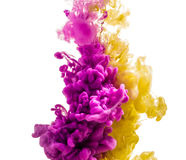 Colorful ink isolated on white background. pink yellow  drop swirling under water. Cloud of ink in water. Stock Photo