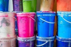 Colorful ink paint bottles in a row stacked. In a print factory Royalty Free Stock Images