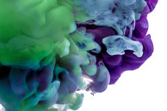 Colorful ink. purple blue drop swirling under water. Cloud of ink in water. abstract background. Colorful ink. a purple blue drop swirling under water. Cloud of Stock Photography