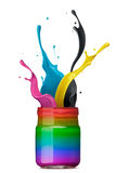 Colorful ink splashing. Bottle of rainbow color ink with cmyk splash Stock Image