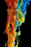 Colorful ink swirling. Through water royalty free stock photo