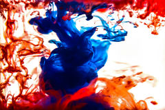 Colorful ink swirling in water Stock Image