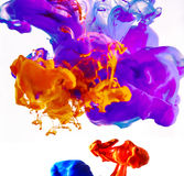Colorful ink swirling in water Stock Images