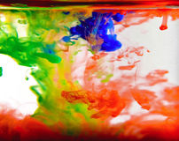 Colorful ink swirling in water Royalty Free Stock Photo
