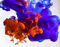 Colorful ink swirling in water Stock Photos