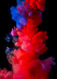 Colorful ink in water Stock Photos