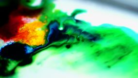 Colorful inks spreads in white paint. Mixing colors, abstraction. The concept of chemistry tests demonstration and. Experiments stock video