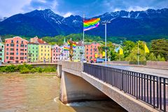 Colorful Innsbruck architecture and Inn river view. LGBT flags on the pole, Alps region of Tyrol, Autria royalty free stock photo