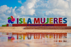 Colorful inscription Isla Mujeres on caribbean sea coast. Colorful inscription Isla Mujeres Island of the Women on caribbean sea coast, Mexico stock images