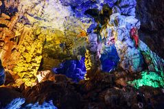 Colorful inside of Hang Sung Sot cave world heritage site. In Halong Bay, Vietnam royalty free stock photos
