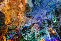 Colorful inside of Hang Sung Sot cave world heritage site. In Halong Bay, Vietnam royalty free stock photography