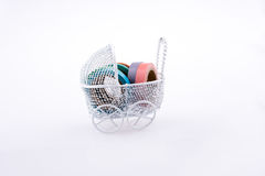 Colorful insulating adhesive tapes in baby carriage Royalty Free Stock Photos