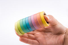 Colorful insulating adhesive tapes  in hand Royalty Free Stock Photos