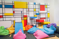 Colorful interior children public playroom with pillows and painted Stock Image