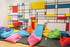 Colorful interior children public playroom with pillows and painted Royalty Free Stock Photos
