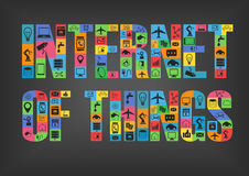 Colorful internet of things characters spelling word with icons. On dark background Royalty Free Stock Images