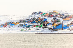 Colorful Inuit houses on the hill, at sea shore, Aasiaat city Stock Photography