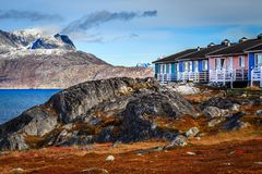 Colorful Inuit houses among the rocks and heavy stones with Serm Royalty Free Stock Images