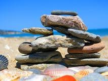 Colorful Inuksuk. Inuksuk made with colorful beach rocks Royalty Free Stock Image