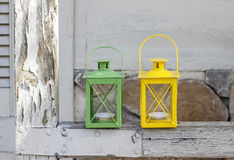 Colorful iron lanterns on rustic wooden porch Royalty Free Stock Photo