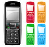 Colorful Isolated Cell Phones. A modern colorful cell phone in many different colors. The screens are blank and have a shine reflected on it Royalty Free Stock Image
