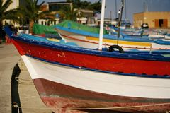 Colorful Italian Boats. Italian boats sitting in a row on the beach stock image