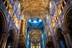 Colorful italian church interior view - Ceiling. With religious images Stock Images