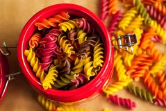 Colorful italian fusilli pasta. In a jar royalty free stock photos