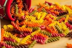 Colorful italian fusilli pasta. In a jar stock photo