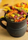 Colorful italian fusilli pasta. In a jar royalty free stock photography