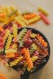 Colorful italian fusilli pasta. In a jar royalty free stock photo