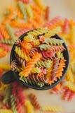 Colorful italian fusilli pasta. In a jar stock images