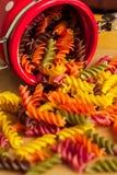 Colorful italian fusilli pasta. In a jar stock image