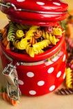 Colorful italian fusilli pasta. In a jar stock photos