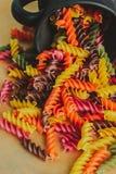 Colorful italian fusilli pasta. In a jar stock photography