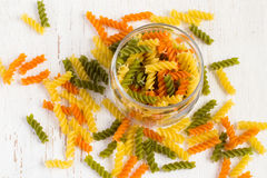 Colorful italian fusilli pasta in a jar on a white background Stock Photography