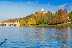 Colorful italian park with trees and autumn colors and water. Italian Park with trees and colorful autumns Stock Image