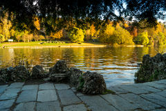 Colorful italian park with trees and autumn colors and water. Italian Park with trees and colorful autumns Stock Photos