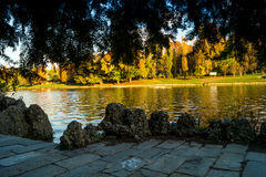 Colorful italian park with trees and autumn colors and water. Italian Park with trees and colorful autumns Royalty Free Stock Image