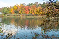 Colorful italian park with trees and autumn colors and water. Italian Park with trees and colorful autumns Royalty Free Stock Photos
