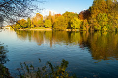 Colorful italian park with trees and autumn colors and water. Italian Park with trees and colorful autumns Stock Photo