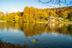 Colorful italian park with trees and autumn colors and water. Italian Park with trees and colorful autumns Stock Images