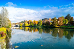 Colorful italian park with trees and autumn colors and water. Italian Park with trees and colorful autumns Royalty Free Stock Images