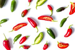 Colorful jalapenos peppers on white background Stock Photos