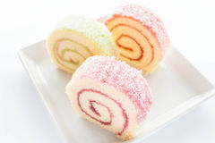 Colorful jam roll cakes  on the dish Stock Images