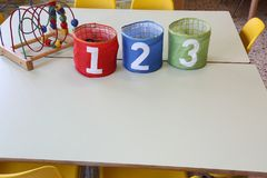 Jar with text one two three on the table in the primary school. Colorful jar with text one two three on the table in the primary school royalty free stock photos