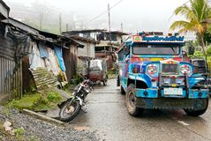 Colorful jeepney riding on a road in Banaue town stock photo