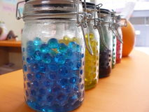 Colorful Jelly balls in glass jar Royalty Free Stock Photos