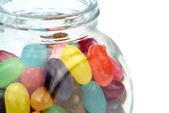 Colorful jelly beans in jar . Macro shot Stock Photography